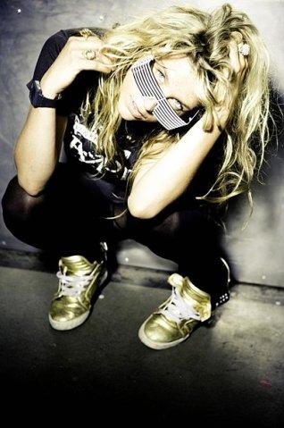 Ke$ha tentée par la musique country